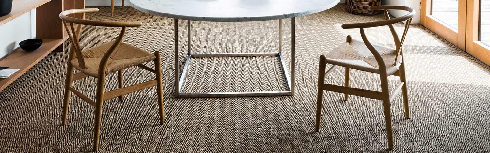 Seagrass carpet in a fine herringbone weave in natural colour
